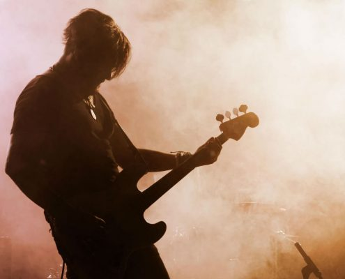 Silhouette of a guitarist on stage